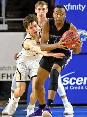 Grayson Murphy (2) attempts to steal the ball from Southwind's Robert Boyd (1) as Independence plays Southwind in the TSSAA Class AAA semifinal game Friday.