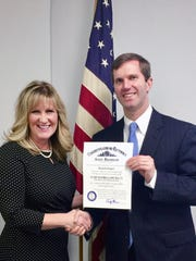 Michelle Kuiper with the Kentucky Attorney General Andy Beshear after receiving an award for being elected into the KY AG Survivor Council, the first council of its kind in the United States.  Kuiper was elected by her 26 peers as cochair.