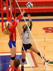 Lakewood's Audrey McCullough and Newark Catholic's Kelly Clapper battle for a ball at the net during Tuesday's Licking County League match.