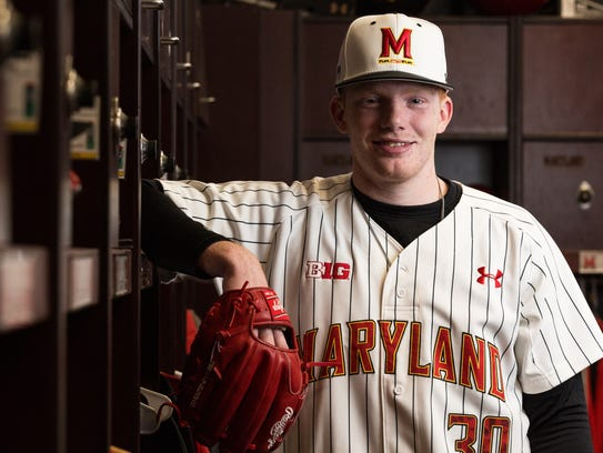 University of Maryland pitcher Sean Fisher (30) poses
