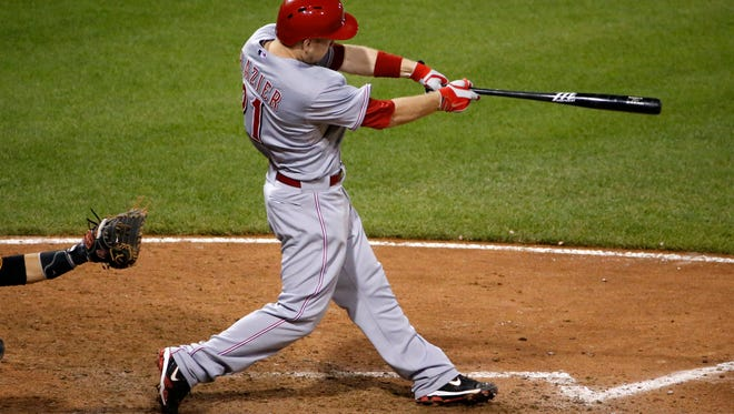 The Reds' Todd Frazier hits a solo home run during the ninth inning of Tuesday's win in Pittsburgh.