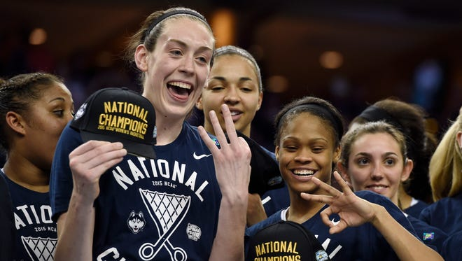 Connecticut forward Breanna Stewart (left) and guard Moriah Jefferson (right) show three fingers signifying the Huskies' third consecutive national championship after winning it 2015.