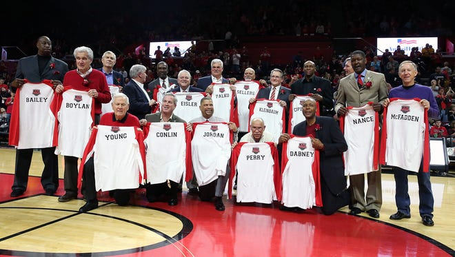 Rutgers men's basketball game vs. Nebraska,  and the halftime ceremony is honoring the 1976 Final Four team (this is the 40th anniversary year) at the RAC in Piscataway on Saturday January 9, 2015. The 1976 Rutgers Final Four mens basketball team pose for a photograph after they were honored at half time.