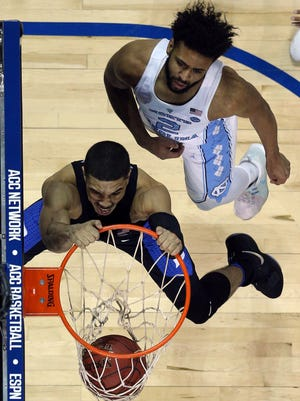 Duke Blue Devils forward Jayson Tatum (0) dunks against North Carolina Tar Heels guard Joel Berry II (2) during the second half of an ACC Conference Tournament game at Barclays Center.