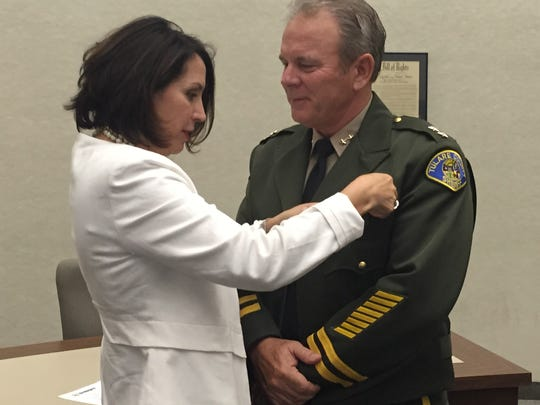 Scott Logue, 53, was promoted to the third highest position in the Tulare County Sheriff's Department — assistant sheriff — by Sheriff Mike Boudreaux on Tuesday. He was pinned with his new badge by his fiance Darlene Mata.