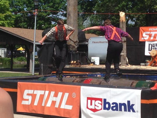 Logan Aldean, left, and Leaf Johnson compete in the log rolling event at the Lumberjacks show.