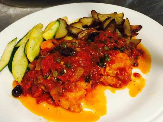 Filet of Sole Livornese with tomatoes, garlic, gaeta olives and capers.