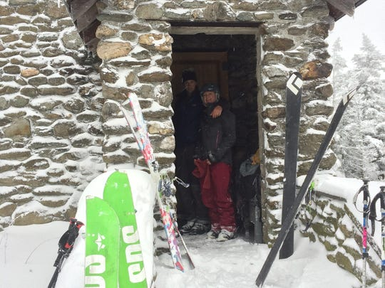 Michael and Alex Kavouksorian of Jericho huddle under the Stone Hut entrance before heading down hill.