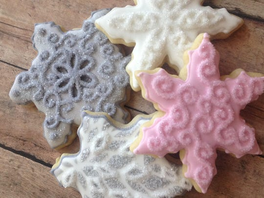 Snowflake cookies are fashioned using some of the more than 800 cutters used by Taylor Smith, founder of Tot's Treats of Reno.