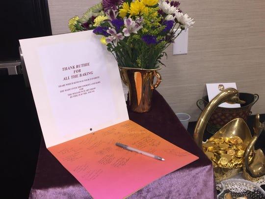Patrons of the Wild Bunch Art Show at the Hampton Inn can sign a thank-you note for 85-year-old Ruth, who made more than a dozen varieties of treats for the event.
