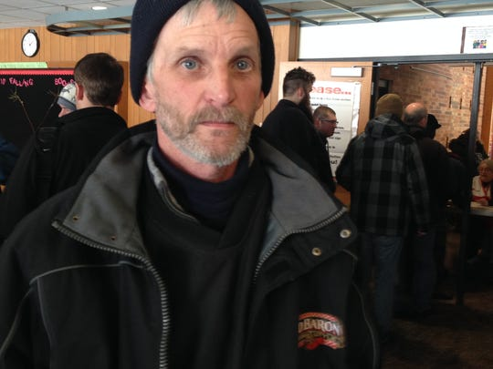 Rick Johnson of Battle Creek was keeping warm at a Red Cross warming center after being involved in a massive pileup on I-94 Friday.