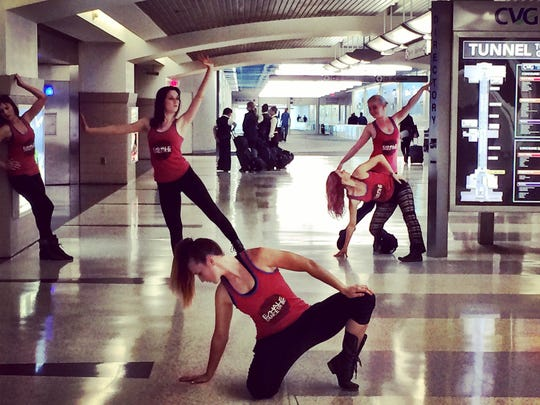 Contemporary jazz dance company Exhale Dance Tribe celebrates its first decade with a pair of concerts, Feb. 7-8 in the Aronoff Center's Jarson-Kaplan Theater, 650 Walnut St., downtown. In this 2014 photo, company members are seen performing in an underground passageway at the Cincinnati/Northern Kentucky International Airport.