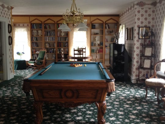 A large upstairs room was used to home school three of the Schuster children and it also served as a small library and billiard room.