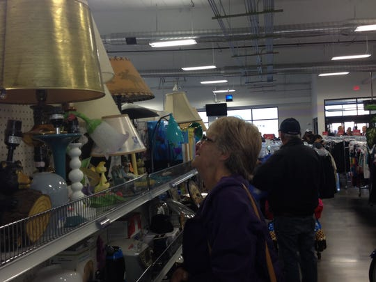 Alice Mullin of Great Falls looks through the housewares selection at the new Goodwill store at 1201 7th St. S., which opened at 8 a.m. Thursday to a large crowd.