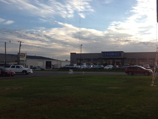 Customers at the new Goodwill store at 1201 7th St. S. are directed to overflow parking across the street. The grand opening at 8 a.m. Thursday drew huge crowds.