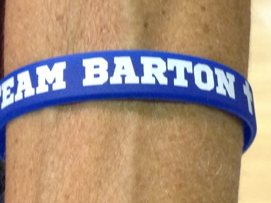 The La Quinta High School volleyball team wears these on their wrists in support of former coach Gary Barton.