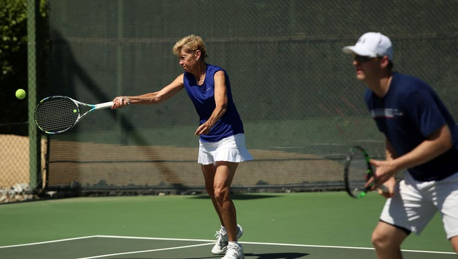 Suzanne Nash of Dallas returns a serve while playing with son and doubles partner Cameron Nash during the bronze match for third place in the USTA Mother-Son Hard Court Championships on Sunday, May 8, 2016 at The Springs Country Club in Rancho Mirage, Calif. The pair defeated Susie and A.J. Nelson of Shreve, Ohio.