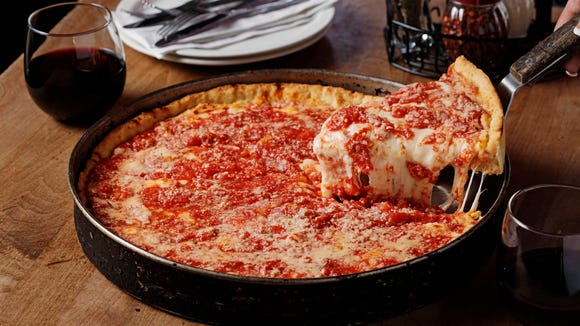 A slice of Lou Malnati's famous deep dish pizza,