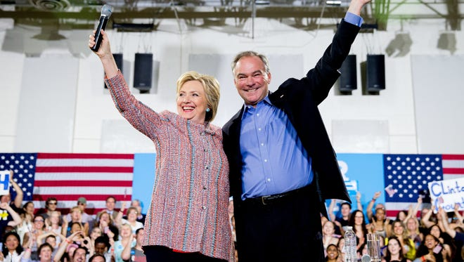 Democratic presidential candidate Hillary Clinton, accompanied by Sen. Tim Kaine, D-Va., at a rally at Northern Virginia Community College in Annandale, Va. on July 14, 2016. Kaine was announced as Clinton's vice presidential choice on Friday.