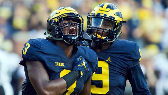 Michigan defensive end Rashan Gary, left, celebrates a sack alongside linebacker Mike McCray in the first half in Ann Arbor on Sept. 17, 2016.