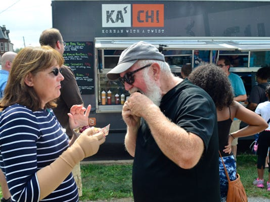 Francoise and Denny Hultzapple of Newberry Township share a meal from the Ka'Chi truck during Foodstruck at Penn Park Sunday, August 31, 2014. Randy Flaum photo - rflaum@yorkdispatch.com