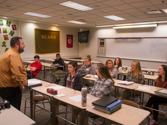 Central High School teacher Jeff Johnson, left, goes over a series of trials his AP Psychology class participated in moments earlier.