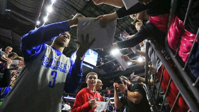 Kentucky's Tyler Ulis signs autographs with fans after the Wildcats' practice session Wednesday afternoon at Wells Fargo Arena in Des Moines before Thursday's NCAA tournament game.