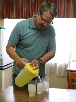 Randy Lee pours lemonade before lunch with three of the boys he and his wife foster in Joy Cottage at the Louisiana Baptist Children's Home in Monroe on Friday, June 10.