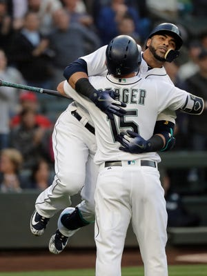 Nelson Cruz embraces Kyle Seager after Cruz's solo home run during the fourth inning of Monday's game against the Los Angeles Angels.