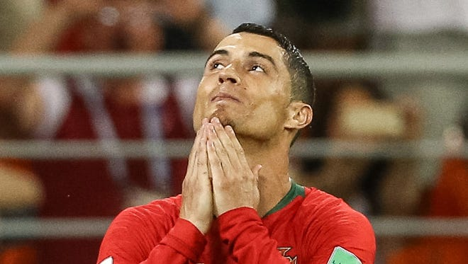 Cristiano Ronaldo reacts after missing a penalty in the second half against Iran.