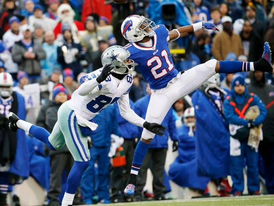 Dallas Cowboys wide receiver Terrance Williams, left, and Buffalo Bills strong safety Leodis McKelvin compete for a pass from Cowboys quarterback Kellen Moore during the first half of an NFL football game, Sunday, Dec. 27, 2015, in Orchard Park, N.Y. (AP Photo/Bill Wippert)
