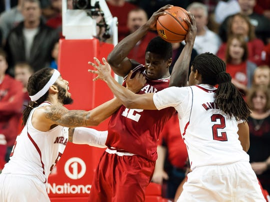 Indiana Hoosiers forward Hanner Mosquera-Perea (12) fights for a round against Nebraska Cornhuskers forward Terran Petteway (5) and forward David Rivers (2) at Pinnacle Bank Arena.
