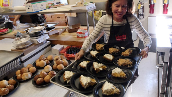 Volunteer Nancy Mendez of Essex Fells with dessert as more than 100 people enjoyed a feast at NewBridge Services 22nd annual Thanksgiving celebration at the First Reformed Church of Pompton Plains. November 25, 2015, Pompton Plains, NJ.