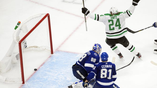 Dallas Stars left wing Roope Hintz (24) reacts as teammate Joel Kiviranta, not shown, scores past Tampa Bay Lightning goaltender Andrei Vasilevskiy (88) during second period NHL Stanley Cup finals action in Edmonton on Saturday, September 19, 2020. THE CANADIAN PRESS/Jason Franson