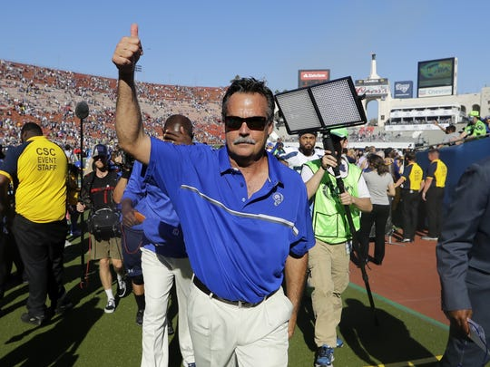 Head coach Jeff Fisher gives a thumbs-up to the Coliseum crowd after the Rams beat the Seahawks 9-3 Sunday in their first regular-season game at home since moving back to Los Angeles.