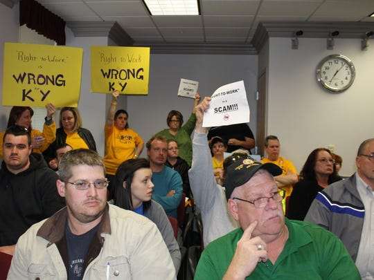 Representatives from the United Food and Commercial Workers International Union from Walton Kroger held signs in the back of the Boone County Fiscal Court meeting Tuesday, March 17.