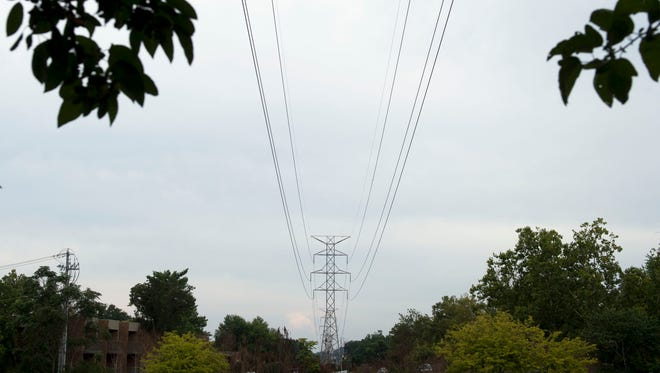 TVA power lines span above shopping complexes and neighborhoods in west Knoxville.