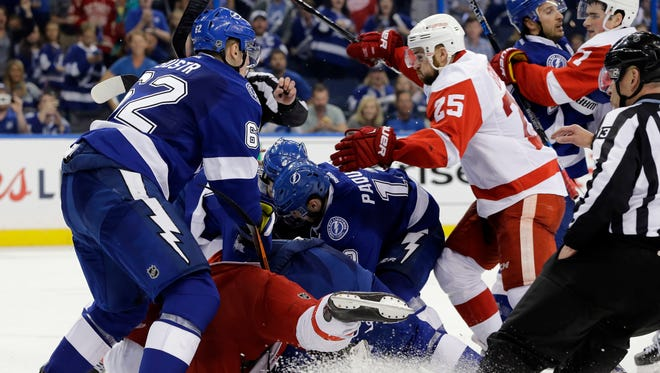 Players from the Lightning and the Red Wings fight during the third period of Game 2 in a first-round NHL hockey Stanley Cup playoff series Friday, April 15, 2016, in Tampa, Fla. Tampa Bay won 5-2. (AP Photo/Chris O'Meara)