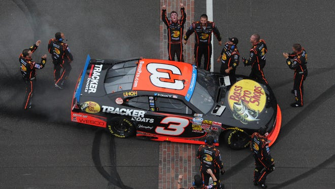 Ty Dillon and crew celebrate a Nationwide Series win at Indianapolis Motor Speedway. July 26, 2014