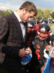 Lions quarterback Matthew Stafford signs autographs