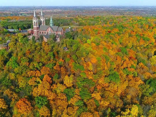 A canopy of fall colors surrounds The Basilica of the National Shrine of Mary, Help of Christians, at Holy Hill near Hubertus on Oct. 19, 2017.