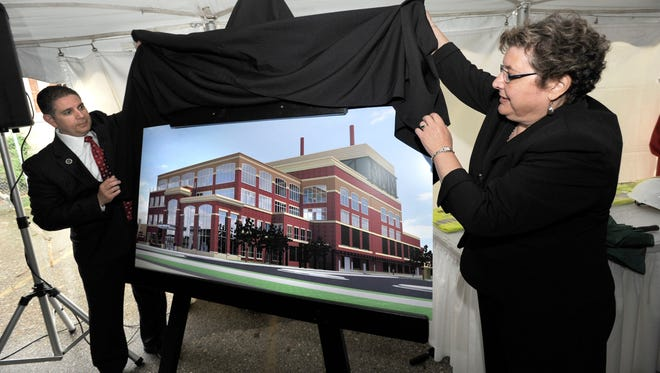 Lansing Mayor Virg Bernero and Board of Water & Light Commissioner Sandra Zerkle take part in groundbreaking ceremonies in May 2011 for BWL's REO Town power plant and headquarters.