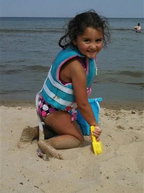 This undated photo released Saturday, Nov. 8, 2014 by the Milwaukee Police Department, shows Laylah Petersen, who died after being shot in the head while sitting on her grandfather's lap Thursday. (AP Photo/Milwaukee Police Department)