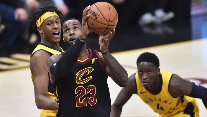 Cleveland Cavaliers forward LeBron James (23) drives to the basket against Indiana Pacers center Myles Turner (33) and guard Victor Oladipo (4) during the first half in game two of the first round of the 2018 NBA Playoffs at Quicken Loans Arena.