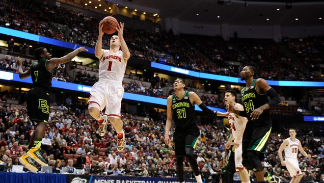 Wisconsin Badgers guard Ben Brust (1, right) drives to the basket against Baylor Bears guard Kenny Chery (1, left) during the second half in the semifinals of the west regional of the 2014 NCAA Mens Basketball Championship tournament at Honda Center.