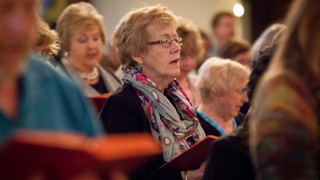 The congregation inside the High Street Methodist Church sings a hymn in 2015 for the 35th annual Thanks-Singing Festival hosted by Christian Ministries of Delaware County.
