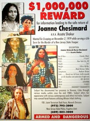 This reward poster provided by the New Jersey State Police, announces the federal reward of $1 million for the capture of convicted cop killer Joanne Chesimard in West Trenton, N.J., May 2, 2005. Chesimard, who now calls herself Assata Shakur, was convicted of the murder of Trooper Werner Foerster but escaped from prison in 1979 and has been living in Cuba under the protection of Fidel Castro's government. Brooklyn Councilman Charles Barron on Tuesday, May 24, 2005, is calling on the United States to rescind the $1 million bounty for Chesimard, describing her as an innocent victim of racial bias.