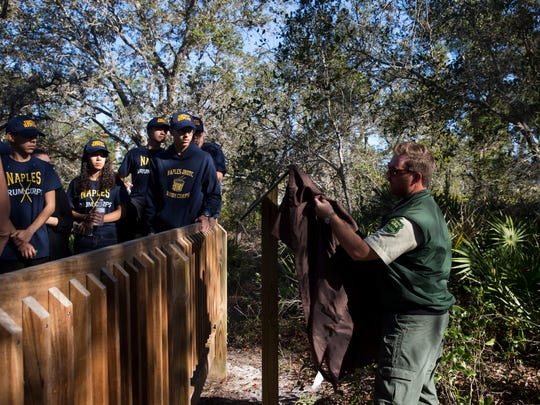 Clark Ryals, a senior forester with the Florida Forest Service, unveils the new informational plaque for the Naples Preserve's National Champion myrtle oak Tuesday, Jan 17, 2017, in Naples. The Naples Preserve's myrtle oak was recognized by the American Forests, an organization that started the registry of champion trees in 1940, and stands 41 feet tall. Designated as a National Champion, it is officially recognized as the tallest of its species in the United States.