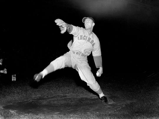 Cincinnati Reds' lefty Johnny Vander Meer warms up before a game against the Brooklyn Dodgers which marked the first night game at Ebbets Field, June 15, 1938.  (AP Photo)