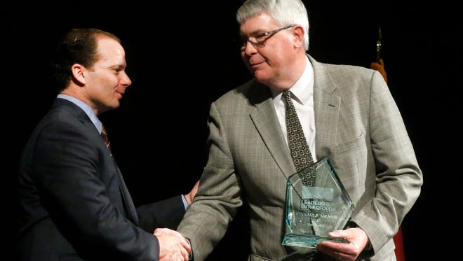Adam Coggin, left, presents Teb Batey, right, with the Leadership Rutherford Pinnacle Award during the Business at Its Best program held at the Embassy Suites Murfreesboro Hotel & Conference Center on Thursday, Feb. 1, 2018.